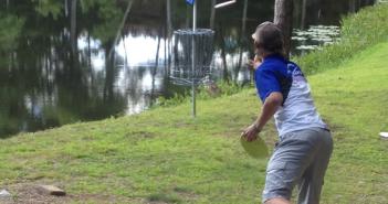 Cameron Colglazier makes a birdie on hole 14. (Photo: PDGA Media)